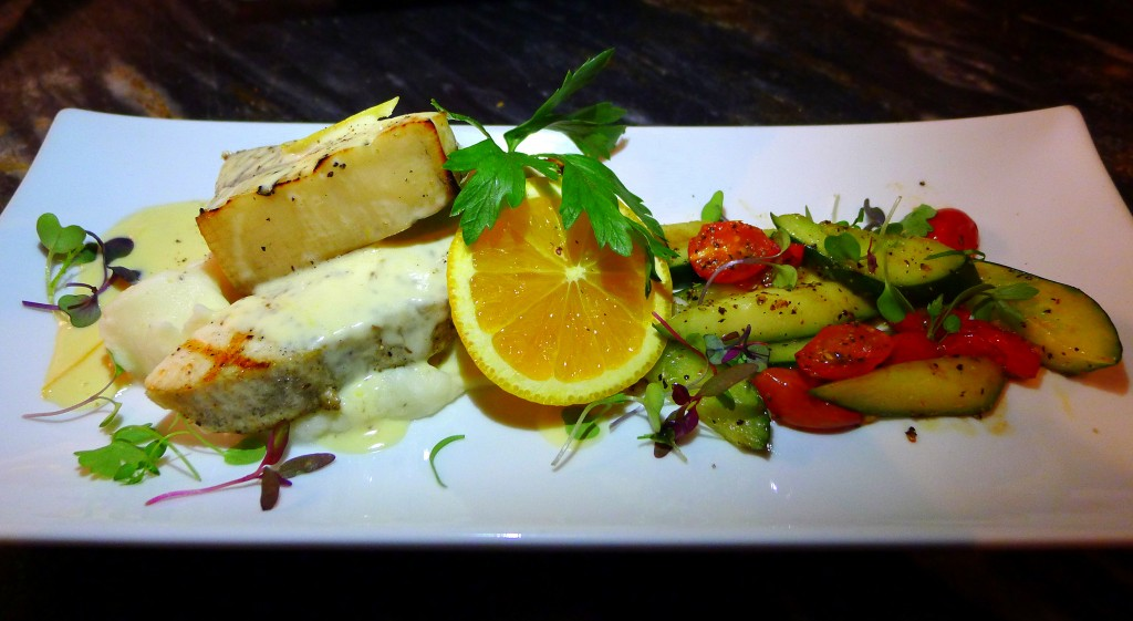 Roast swordfish over mashed potatoes with sauteed cucumbers and orange beurre blanc